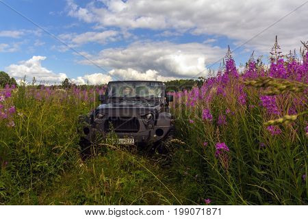29.07.2017. Leningrad region. Russia. Jeep Wrangler with forest road in the Leningrad region. Wrangler is a compact SUV manufactured by Chrysler