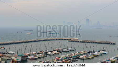Spectacular Sea In Front Of Harbor, Pattaya Modern City In Smog From The Scenic Point During Sunset
