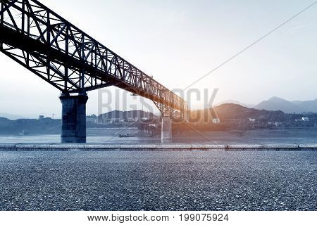In the asphalt road in front of the railway bridge the Yangtze River Three Gorges.