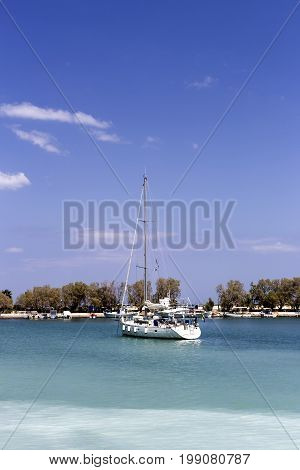 The view of the sea and moored yacht on a sunny day