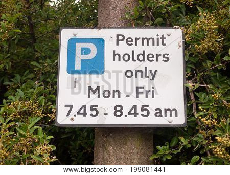 Close Up Of Permit Holders Only Parking Sign