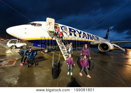 SANTIAGO DE COMPOSTELA SPAIN - MAY 10 2017: Passengers disembarking Ryanair flight from Milano Italy to Santiago Spain at night. Ryanair is biggest budget low-cost airline in the world.