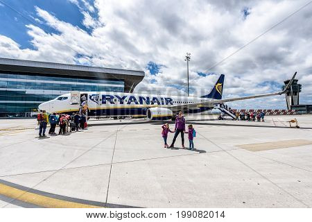 SANTIAGO DE COMPOSTELA SPAIN - MAY 19 2017: Passengers boarding Ryanair flight from Santiago Spain to Milano Italy on a sunny day. Ryanair is biggest budget low-cost airline in the world.