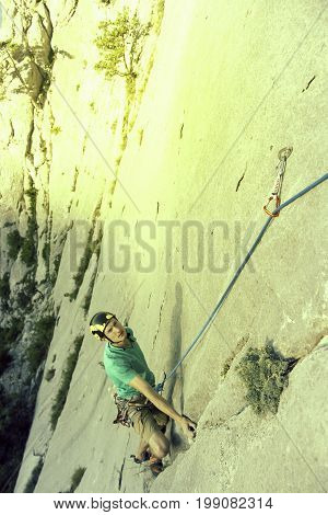 Rock Climber Ascending A Challenging Cliff. Extreme Sport Climbing. Freedom, Risk, Challenge, Succes