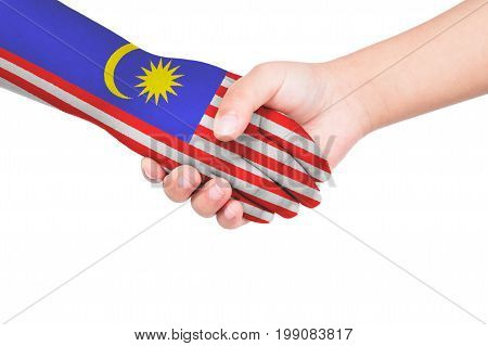 Handshake Between A Child And Malaysia