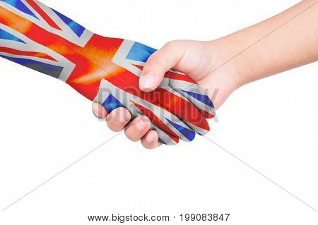 Handshake between a child and United Kingdom with flags painted on hand in isolated white background