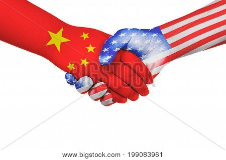 Handshake between China and United States of America with flags painted on child's hands in isolated white background
