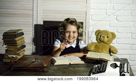Small Girl With Curler In Hair Read Book.