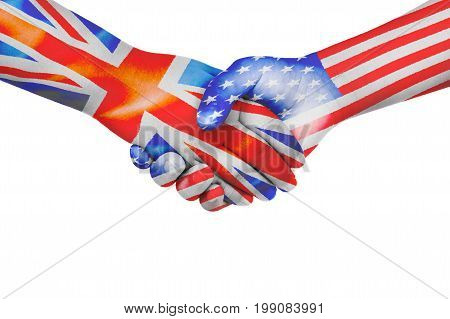 Handshake between United States of America and United Kingdom with flags painted on child's hands in isolated white background