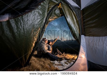 View From Inside A Tent On The Two Tourists Have A Rest In The Camping In The Mountains At Night. Me