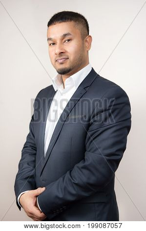 well dressed young business man isolated white background.