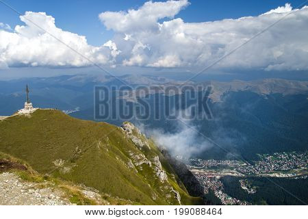 Aerial view of mountain resort from the top: Heroes Cross and Busteni resort in Bucegi Mountains Romania