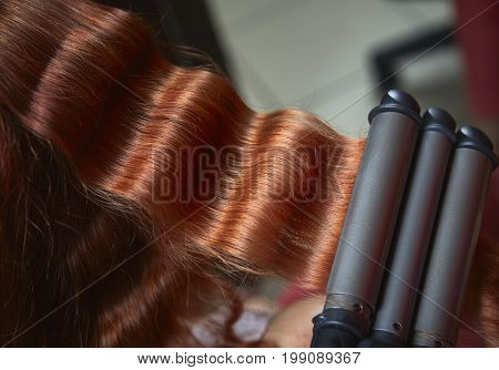 Red Hair Curled With Triple Barrel Curling  Iron