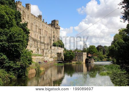 Warwick, Uk - July 22 2017: Warwick Castle, Mill And Weir On The River Avon