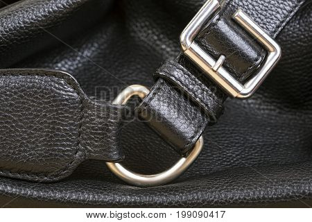 Belt of leather bag . Black Leather Bag Close Up. Macro shot