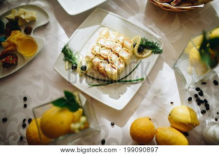 Delicate composition with food and fruits. Lemon composition wedding.