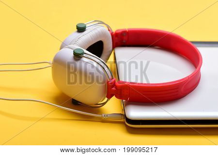 Sound Recording And Digital Equipment Concept. Headphones And Silver Laptop