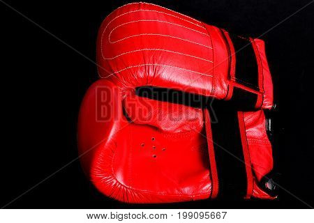 Red Boxing Gloves For Heavyweight Sport Isolated On Black