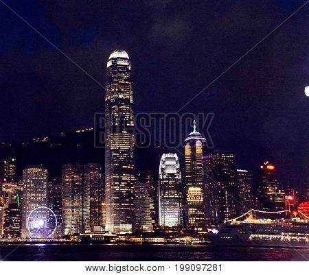 Hong Kong skyline view from Kowloon side, colorful night.