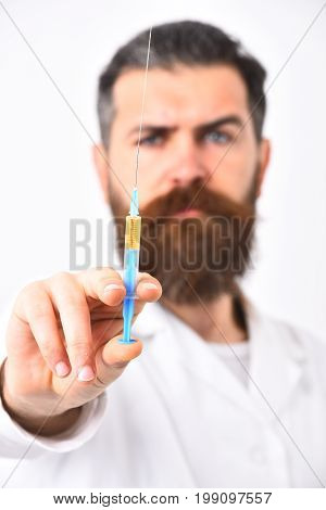 Bearded Doctor With Stylish Haircut Holding Syringe