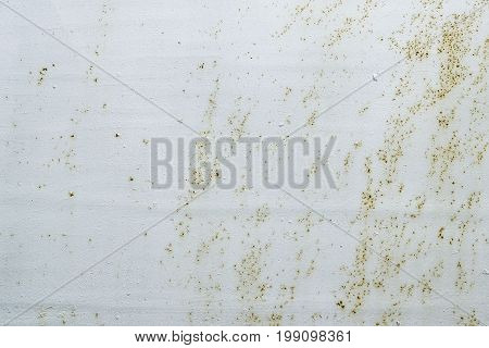 Peeling paint and rusty old metal background. Flaking paint and corrosion on grey metal. Grunge texture