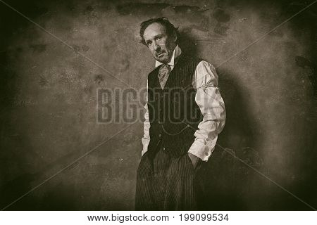 Classic Wet Plate Photo Of Vintage 1900 Western Man Leaning Against Wall.