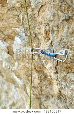 climbing quickdraw fixed on jumper on the cliff and the rope. climbing equipment in use
