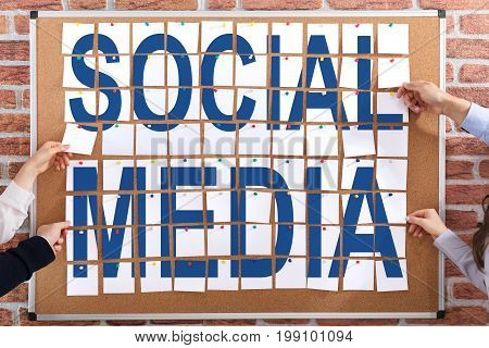 Social Media Text Made With Adhesive Notes Attached On Corkboard