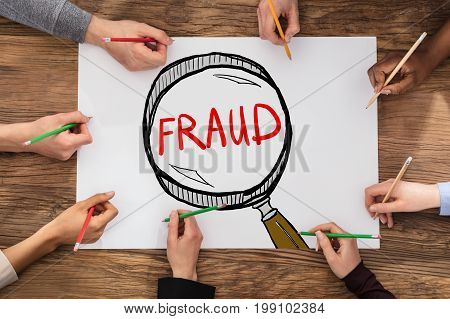 People Drawing Fraud Investigation And Audit Concept In Notepad