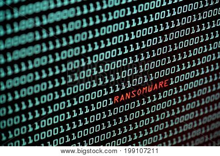 Ransomware or Wannacry text and binary code concept from the desktop screen. concept background selective focus
