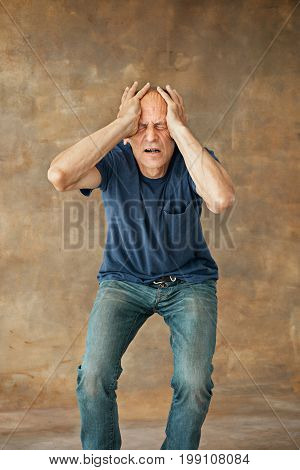 The profile of screaming mature man at studio