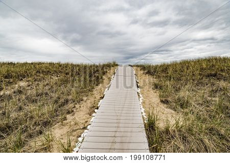 Wooden path over dunes at beach. South of Maine USA