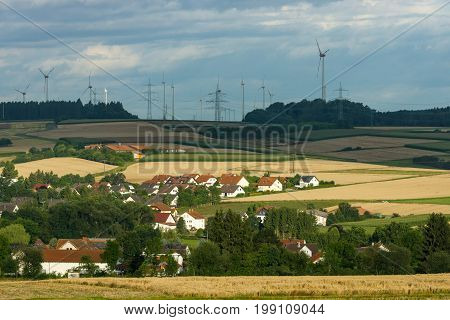 View of the small town of Neustadt (Marburg-Biedenkopf district in Hessen) the suburbs and surrounding agricultural land in the morning sun.