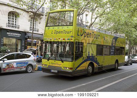 PARIJS , FRANKRIJK - JULY 23 ,2017: Tourist Bus in Paris, France  Paris Open Tour is a touristic bus service that shows the city with an audio guide.