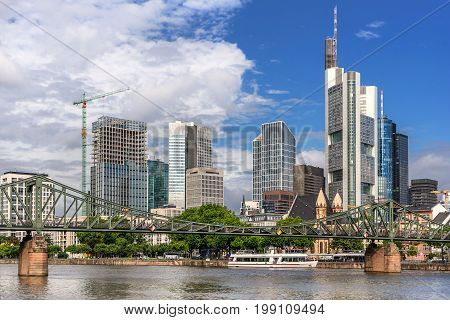 Looking across the Main River to the CBD in Frankfurt AM Main with the Eiserner Steg bridge in the foreground