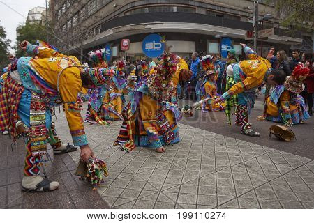 Santiago, Chile - August 5, 2017: Tinkus dance group parading through the centre of Santiago, Chile to mark Independence Day of Bolivia.