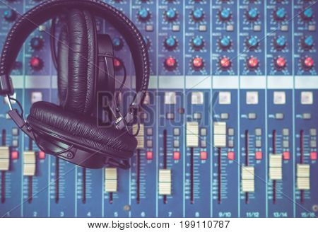 Top view of Earphone on mixer music instrument concept