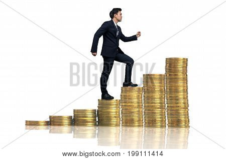 Businessman goes up the stack of gold coins on a white background business investment and success concept
