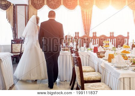 Bride and groom in restaurant. Wedding table at a wedding feast, dinner and party