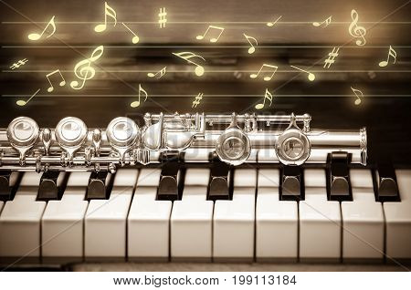 Closeup Flute on the keyboard of piano musical instrument vintage tone