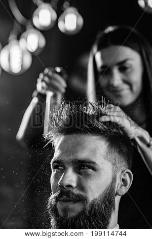 Hair styling man in hair salon blak and white image close up man and woman
