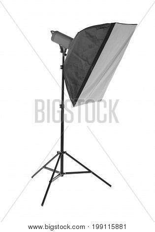 A professional softbox isolated over the white background. Photographic equipment for professionals. A dark black studio softbox on a long metal tripod. Photographic technique.