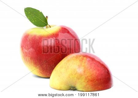 Colourful fresh fruits for healthy summer breakfast and snacks. A close-up picture of natural bright fruits full of vitamins. A whole red and a cut yellow apples, isolated over the white background.