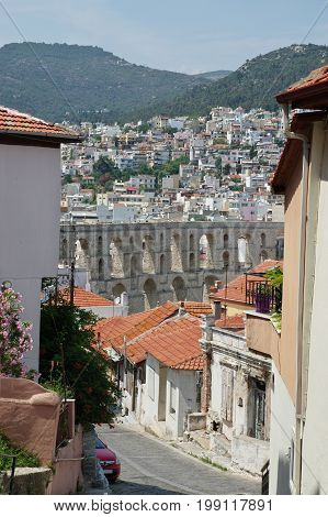 Kavala, city in the northern Greece, in the Macedonia-Thrace region, located on the Aegean Sea. In the background you can see a Roman aqueduct from the 16th century.