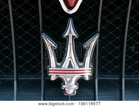 TURIN, ITALY - JUNE 10, 2017: Maserati logo and emblem on a the car grill