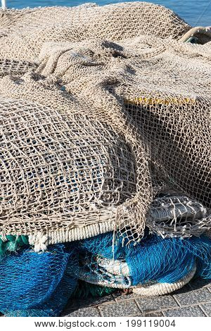 Fishing nets stacked in the harbour of the port Andratx Majorca