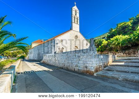 Scenic view at old church in Vis town, tourist resort in Croatia.