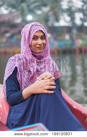Young woman wearing hijab head scarf in city smile happy face portrait, traditional muslim clothes, latest fashion design,