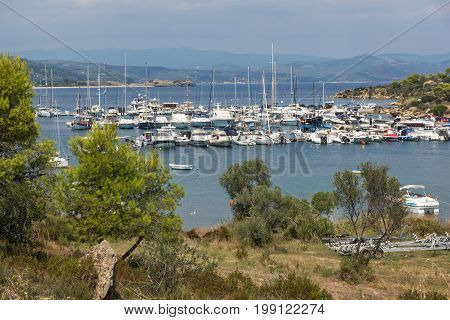CHALKIDIKI, CENTRAL MACEDONIA, GREECE - AUGUST 26, 2014: Seascape of port at Sithonia peninsula, Chalkidiki, Central Macedonia, Greece