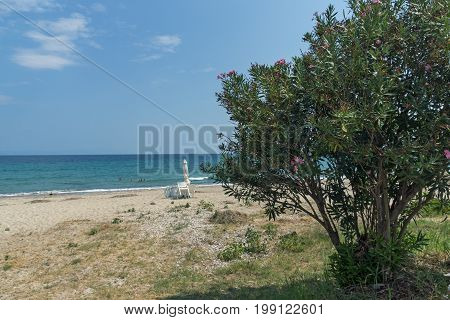 CHALKIDIKI, CENTRAL MACEDONIA, GREECE - AUGUST 26, 2014: Seascape of Assa Maris Beach Agios Nikolaos at Sithonia peninsula, Chalkidiki, Central Macedonia, Greece